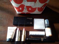 Apple & Bee eco-makeup bag, Dr. Hauschka  eye shadow, Sante eye shadow, Ecco Bella tinted moisturizer, Ilia Beauty lipstick, Dr. Hauschka lipstick, Intelligent Nutrients lip balm, Dr. Hauschka mascara and Erbaviva lemon & sage organic deoderant. I love each and every one of these products!