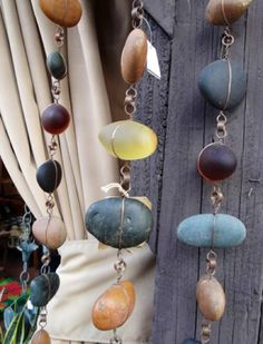 Rock rain chains made with wire wrapped around large handpicked smooth rocks.