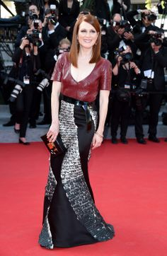 Juianne Moore wearing custom Louis Vuitton with a Petite Malle clutch at Cannes 2014.