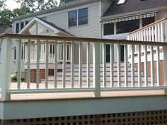 deck specialists inc ipe deck with white vinyl rails and white fascia and riser ct.JPG (1229×922)