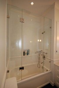 tub slider with shelf and return panel | Frameless glass tub enclosures follow the specifications of frameless ...