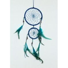 Dream hanging made of beads, cowree, feather, silk thread and metal ring