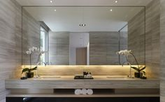 Master Bath - Back lits with full mirror and sleek marble vanity....elegant. (re-pinned photo - SCDA Architects)
