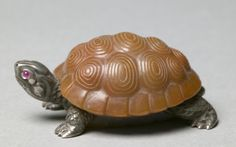 Turtle, firm of Peter Carl Fabergé (Russian, 1846-1920) light brown and grey agate and silver