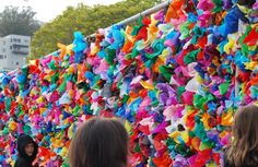colorful decorated chain link fence created by elementary school kids (good for fabric scraps)