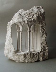 Matthew Simmonds sculpts tiny architectural structures from raw stone. Part of his interest in creating these pieces is centered around the contrast betwee