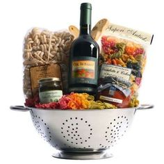 Tuscan Trattoria Italian Wine Gift Basket from Tuscany, Italy - Nestled in a colander are ingredients for savory Italian pasta dinners. Rigantoni pasta, marinara sauce, and prosciutto are paired with Banfi Col di Sasso, a Tu. Themed Gift Baskets, Wine Gift Baskets, Raffle Baskets, Fundraiser Baskets, Gift Baskets For Men, Get Well Gift Baskets, Family Gift Baskets, Holiday Gift Baskets, Wine Gifts