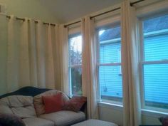 Make curtain rods with metal conduit - pennies per window!
