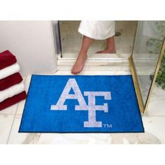 """Air Force Falcons NCAA All-Star"""" Floor Mat (34""""x45"""") AF Logo"""". Each Fan Mats product is produced in a 250;000 sq. ft. state-of-the art manufacturing facility. Only the highest quality; high luster yarn with 16 oz. face weight is used. These mats are chromo jet printed; allowing for unique; full penetration of the color on the machine washable non-skid Duragon latex backing with a sewn edge  - making for a beautiful and lasting piece for even the most aggressive fan.  Anything else would be…"""