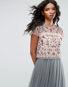 Buy it now. Needle & Thread Posy Embroidered Crop Top - Pink. Top by Needle Thread, Lined chiffon, All-over floral embroidery, Spread collar, Ruffle trim, Cropped length, Tied keyhole back, Regular fit - true to size, Dry clean, 100% Nylon, Our model wears a UK 8/EU 36/US 4 and is 179cm/5'10.5 tall. The creation of British designer Hannah Coffin, Needle Thread translates Hannah�s eclectic design into distinctive dresses and feminine separates. Collections are built up around intricately…