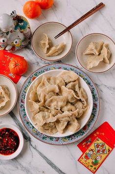 This recipe for pork and fish dumplings Jiaozi comes from the Northern provinces of China, where dumplings are the star of every family's Chinese New Year's Eve celebration. The mix of pork and fish is a wonderfully savory combination, with a mild flavor and texture that makes these dumplings pillowy soft inside.