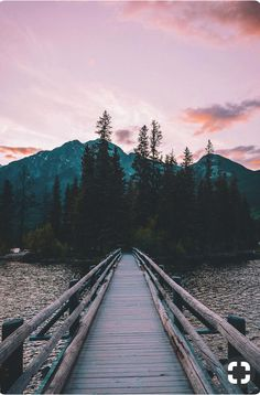 Pastel Painted Sunsets Glistening Off Of The Lakes Surface With Mountains And Trees In View Fresh Air Freedom Walking Pier