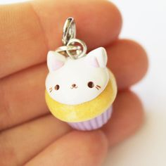 This Cat Cupcake charm is the perfect accessory to add a touch of cuteness to your life! It is made out of strong oven bake polymer clay. The eyepin (finding) is secured with super glue to ensure durability. It was glazed with a high quality gloss varnish for protection and extra shine. ...