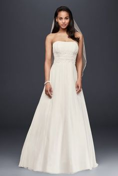 This empire-waist strapless wedding gown is beautifully designed with exquisite hand-beaded lace. The fitted bodice flows into a soft chiffon skirt, the back of which is topped with a beaded lace deta Wedding Dress Chiffon, Wedding Dress Styles, Chiffon Skirt, Beaded Chiffon, Beaded Lace, Allure Bridal, Petite Dresses, Davids Bridal, Flower Girl Dresses