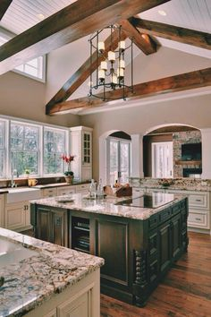 I'm liking this kitchen with the wood beams and wood floor.