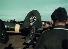 Adolf Hitler at the plane Heinkel He-111 P-2 (trip code 'CA NA', serial number 2471) 'Squadron of the Fuhrer' at the airport on the Eastern Front.