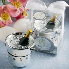 Whimsical Champagne and Ice Bucket Kitchen Timer Wedding Favors, an actual useful kitchen gadget that I love as a favor. Nobody buys these anymore, but I know I'd at least use it.