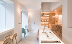 When the businessman Peter Fong decided to build his office on a nondescript corner lot in Guangzhou's Tianhe quarter, he saw a perfect opportunity to also indulge his love for coffee. For the Shanghai-based Lukstudio, the challenge was to stitch toget...