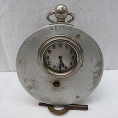 A 20th cent. pigeon racing clock,  numbered 219060