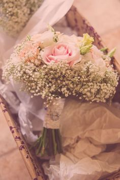 Vintage, fluffy bridal bouquet. Autumn 2013 A mix of Sweet Avalanche, Vandella, and Peach Avalanche Roses, peach double Lisianthus edged with frothy Gypsophila.  Bound in lace, lucky charms from Bride attached to handle.