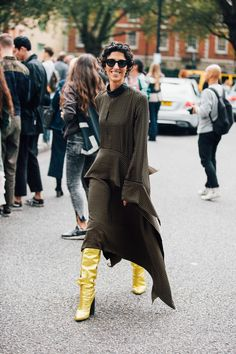 6. Wear party boots 24/7 What do we want to take from Style.com's fashion director, Yasmin Sewell's wardrobe? The eye-popping gold Petar Petrov knee boots spotted peeping out from beneath her oversized day dress.