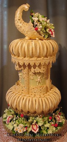 I continue to be amazed at what cake decorators can do.  This intricate cornucopia takes my breath away.