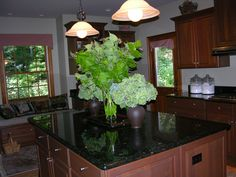Hydrangeas and Leycesteria formosa on the kitchen island.