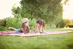 This photo reminds me of my sister and I when we were children. We would lay outside  on the grass and play during the summer.