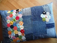 Denim Pillow: patchwork appliqued on top of random jean pieces stitched together.