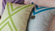 Give pillows a one-of-a-kind look by painting geometric patterns on fabric covers.