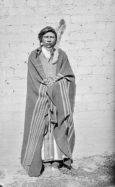 Shoshoni Man in Native Dress Holding Mirror Near Brick Wall 1878  by William Henry Jackson (1843-1942)