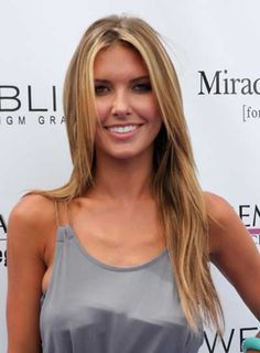 Audrina Patridge's Long, Blonde, Straight Hairstyle is a beachy-chic look for straight hair. Steal her style: 1. To get Audrina Patridge's hairstyle, part your hair down the center to begin. 2. Apply smoothing cream to damp hair and blow dry straight using a paddle brush. 3. Run some styling wax between your fingertips, and rake them through the ends of your hair to add more texture.
