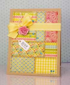 handcrafted greeting  card ... quilt design ... blocks of various sizes and prints ... machine sewing zig zag stitch on interior and straight stitch around the edge ... kraft base ... lovely card ...