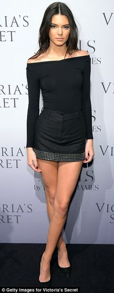 Not leaving much to the imagination: The model wore an off-the-shoulder top, studded mini-...