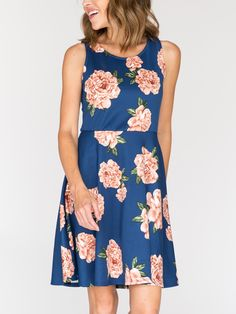 The new denim blue on this is stunning in contrast with the large blooms. the Agnes & Dora fisher dress has a fitted top, a-line skirt. Size up if you are busty, for some extra room.