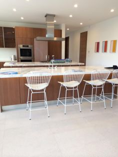More Bertoia barstools and stark white