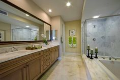 Looks like an ideal place to light a few candles and unwind after a long day.   #masterbathroom #steamshower #bathtub