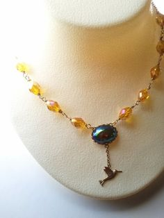 Hummingbird Charm Necklace With Blue by MissShugsJewelryShow