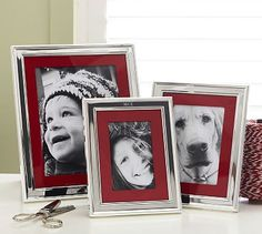Silver-Plated Grosgrain Mat Frames #potterybarn... I love the red mats with the black and white photos, I want to do this in our living room!