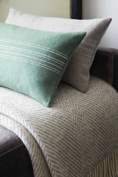 While nights are still chilly, keep cosy and warm with Pad UK's high quality wool and textile products of neat classic design, like the Lurex Stripes Wool Cushion €44.72