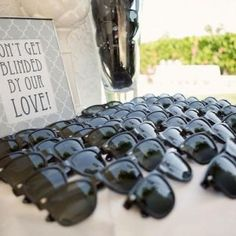 Functional wedding favours - the sunglasses serve a purpose and come with a cute message from the bride and groom.