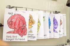 Hang kids artwork from IKEA curtain wire with clips.  Keeps them neat and organized!