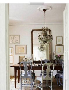 French Dining Room. Love the big mirror and chairs.