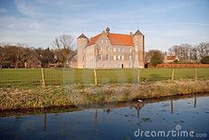 Dutch landscape with moat around castle Croy and farms - Laarbeek - Noord-Brabant - Netherlands.
