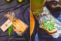 the best mehndi party favor I have ever seen - hand shaped cookies with a cone of green icing to draw designs with. love this idea! my friend's little sister's wedding and photo by the awesome sahid limon.