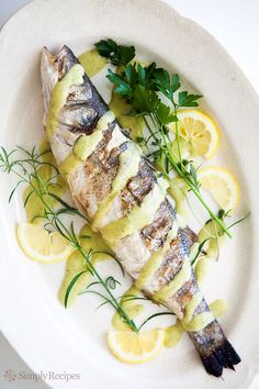 Whole grilled branzino fish, or European seabass, served with a rosemary vinaigrette sauce. Grilling Recipes, Seafood Recipes, Cooking Recipes, Healthy Recipes, Tilapia Recipes, Cooking Tips, Cooking Chef, Whole Fish Recipes, Bon Appetit