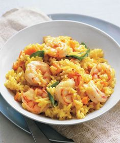 Curried Rice With Shrimp|This Indian-inspired dish will have your mouth watering as it cooks—the shrimp simmers with the rice alongside garlic, curry, carrots, and onions. Fold in basil before serving for a final herbaceous note.