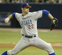 April 25, 2003 Mark Prior helps the Cubs defeat the Colorado Rockies (11-7) with his arm and his bat pitching 7 innings with 7 K's and a home run, double and 4 RBI.