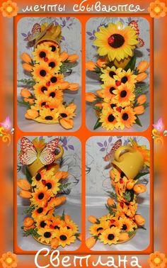 adorno con taza y plato con detalles de girasoles, tulipanes amarillos y mariposa