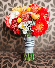 Gorgeous orange, yellow and white floral bouquet. Photo: Tess Pace Photography // Featured: The Knot Blog